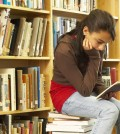yowoto-girl-sitting-on-book-in-library-reading