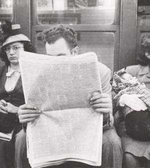 man-reading-newspaper