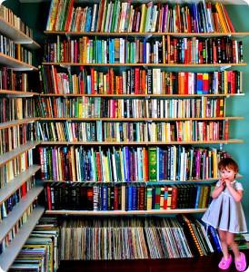 kid-with-bookshelves-medium-274x300